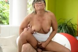 Spex grandma rubs her love tunnel while fucking