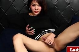 Alluring asian tilf wanks her hard cock