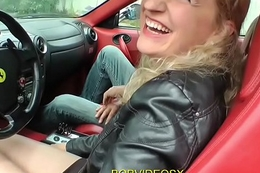 A pretty blonde gets dildo on a Ferrari