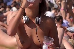 Wonderful brunette girl Topless on the Beach
