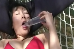 Stuffing her wet vagina with a sex-toy so damn deep